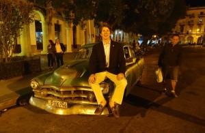 Philip on the hood of a Caddy in Havana, 2015