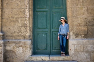 Sarah in a doorway in Havana