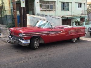 A bright red Oldsmobile